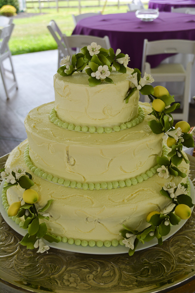Wett Lemon Knoxville, TN  Wedding Cake with buttercream and sugared Lemons decoration