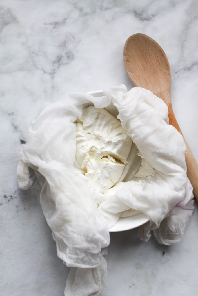 Process of making labneh. Straining through a cheese cloth
