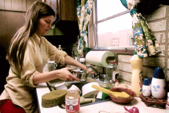 The woman is working in the kitchen