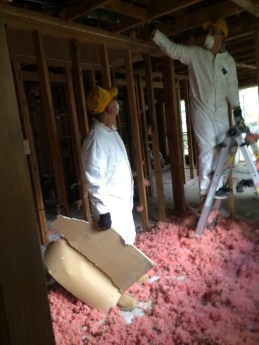 SBCV disaster relief workers remove damaged portions of a ceiling in a home on Nashville Street in Baton Rouge, Sept. 5.