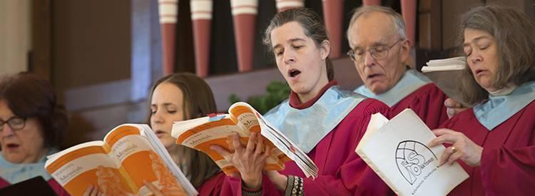 The choir sings music at First Parish Church