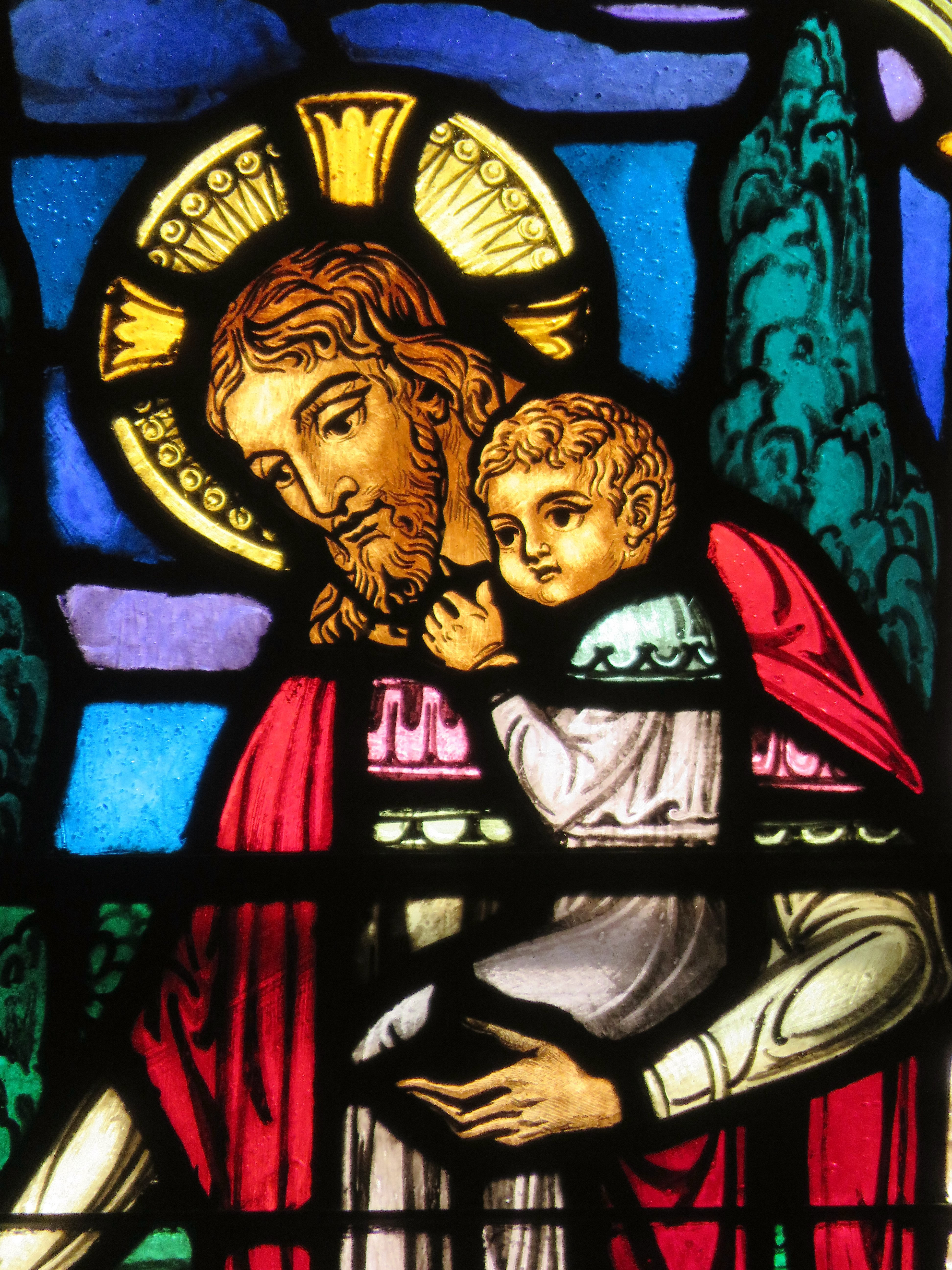 Stained Glass Window of Jesus Holding a Child