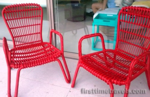Red chairs by our room terrace.