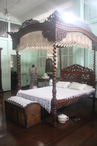 The four-post bed with canopy.