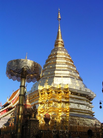 The golden stupa shines brightly under the sun.