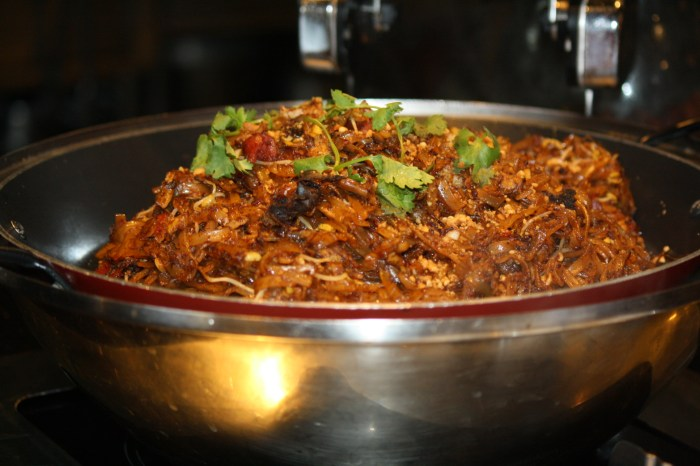 Char Kway Teow is Singaporean flat noodles.