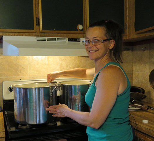 Jen Sadlier stirring milk. Photo by Suzanne Crocker. From FirstWeEat.ca, the Food Security North of 60 website supporting First We Eat, a documentary by Yukon filmmaker Suzanne Crocker about eating only locally-grown foods in in Dawson City, Yukon, in Canada's North, for one year.