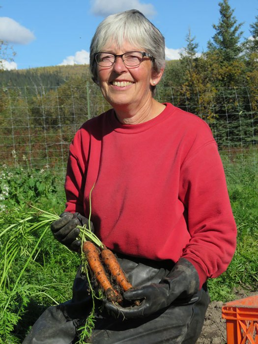 Lucy Vogt and carrots. From FirstWeEat.ca, the Food Security North of 60 website supporting First We Eat, a documentary by Yukon filmmaker Suzanne Crocker about eating only locally-grown foods in in Dawson City, Yukon, in Canada's North, for one year.