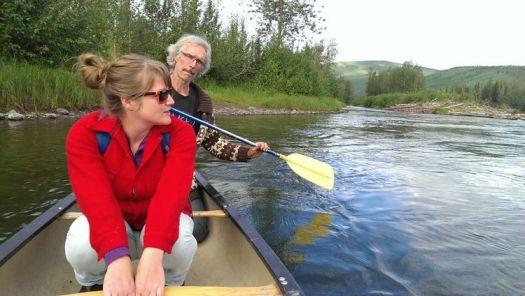 John Lenafrt canoes Dana VanVeller across the Klondike River.