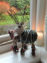 My gorgeous wood and yarn reindeer