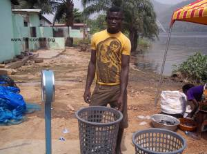 Preparing and selling harvested fish produced in a small-scale farm in Ghana (01)
