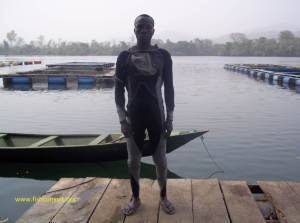 Maintenace of cages in Lake Volta