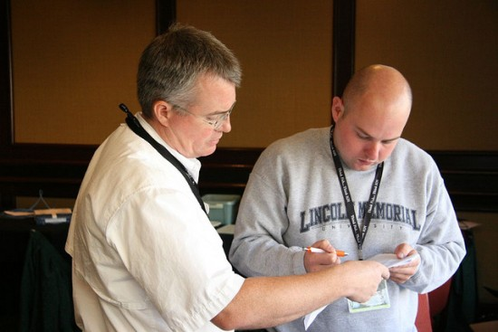 Two American Fisheries Society AFS members consulting