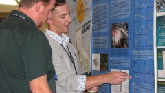 Photo of two members at the annual meeting poster session of the American Fisheries Society annual meeting