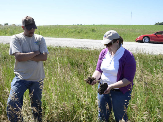 Sarah Carlson, Practical Farmers of Iowa, works with farm operator Ryan Pontier to establish cover crops on the Rabinowitz farm in Clarke County, Iowa.