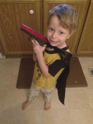 My 3 year old superhero with an NLT SIRT. Yup, finger is on the trigger, not yet ready for the real thing. Baby steps.