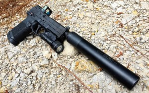 The Griffin Armament Revolution 45 ACP suppressor on the FNX Tactical with Trijicon RMR and Streamlight TLR-1