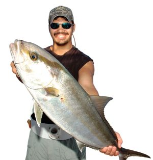Daniel Felsher is all smiles after winning a pitched battle with this amberjack.