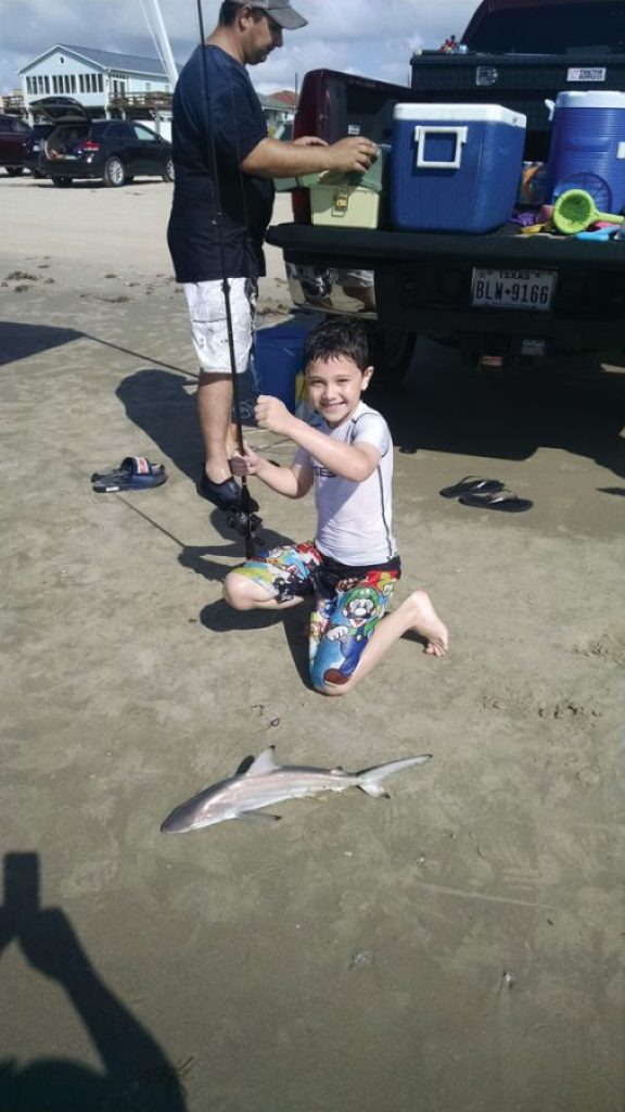 First time to surf fish with his Dad, Konnor Bittner, age nine, caught this blacktip shark off Surfside Beach.