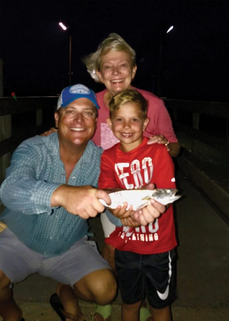 """Anderson """"Upgrade"""" Casey of Dallas shows off his first solo speckled trout, with proud Dad, Lee Casey, and excited Grandmother, """"CiCi."""""""
