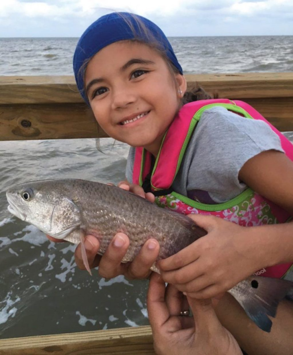 Seven-year-old Abryanna Rivera of Timberwood Park caught this 16-inch red on live shrimp while fishing from a pier on Aransas Bay.