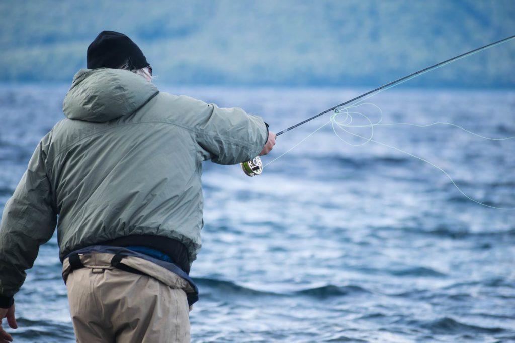 An angler fly fishing on the lake.