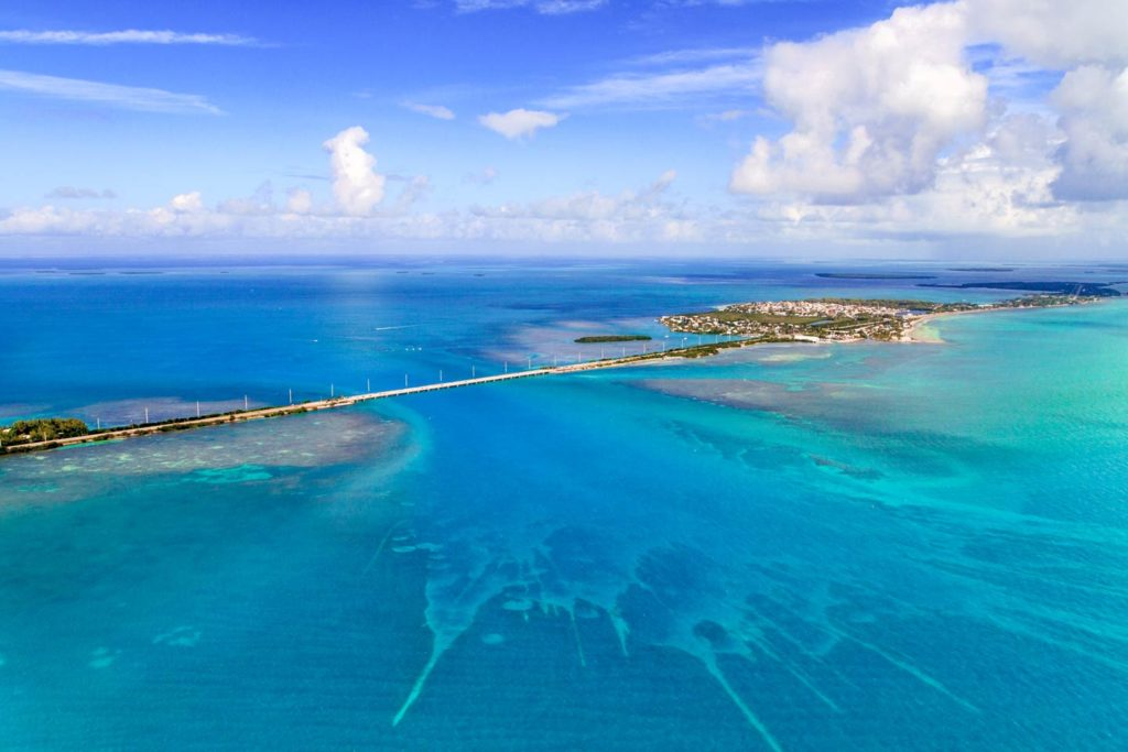 An aerial shot of two islands of the Florida Keys, connected by a road.
