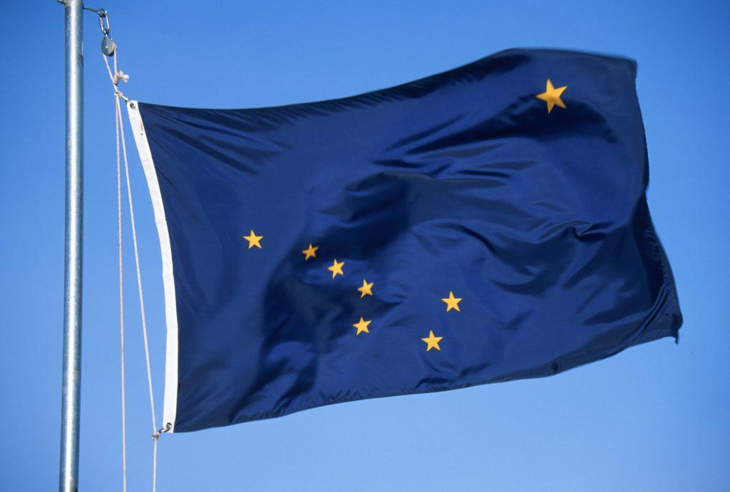Flag of Alaska on the mast against the sky