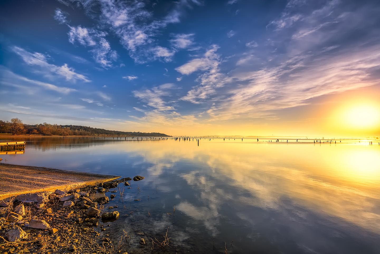 A view across Benbrook Lake, TX, at sunrise
