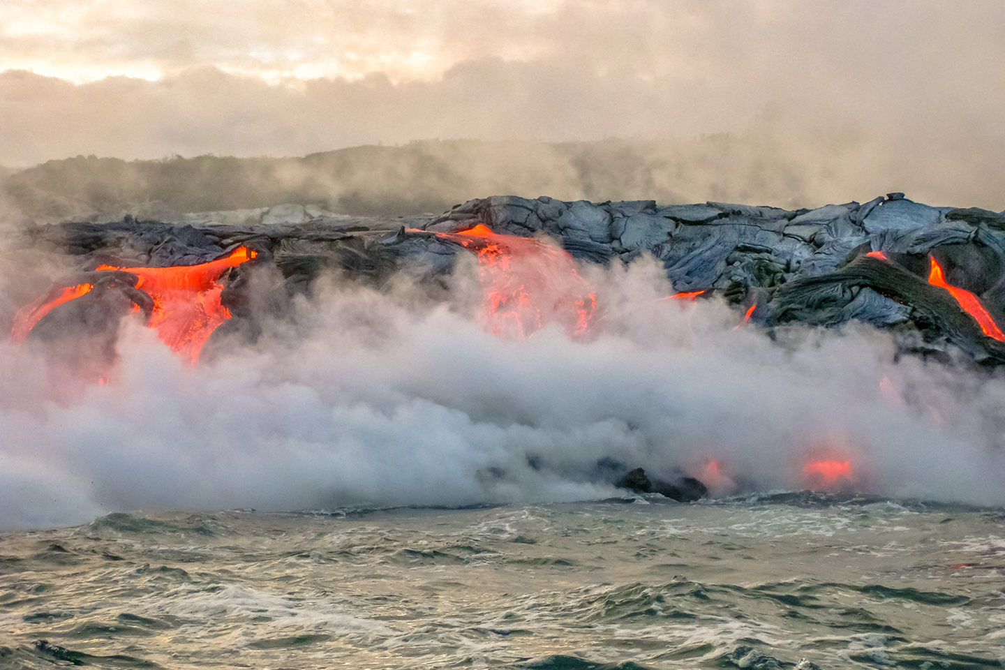 Molten lava flowing into the sea on Big Island, Hawaii.