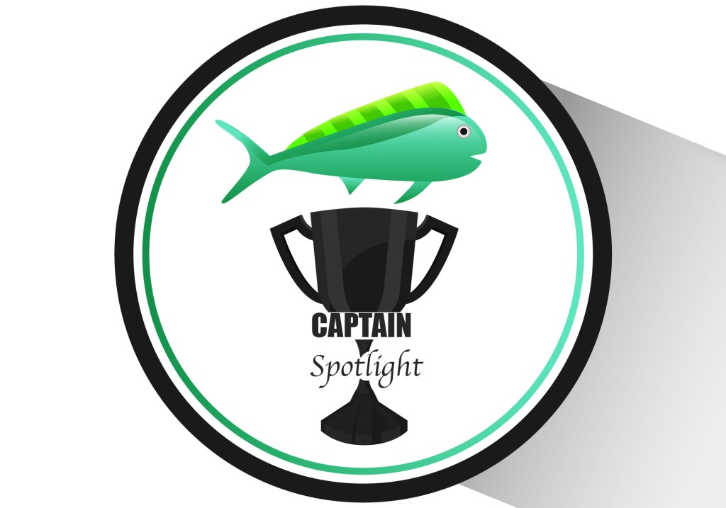 Trophy with fish and captain spotlight caption