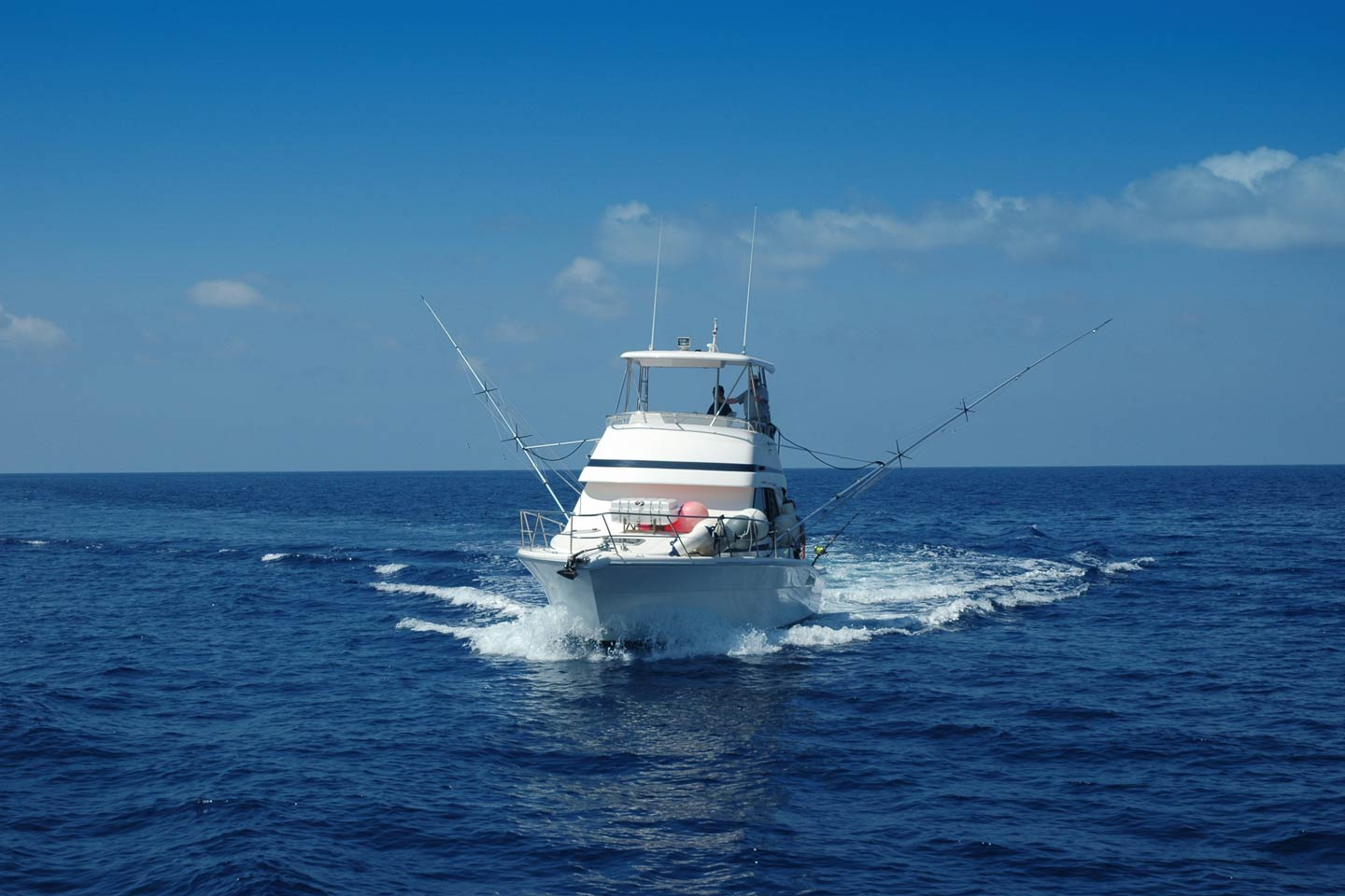 Charter boat heading out for big game fishing in New Smyrna Beach