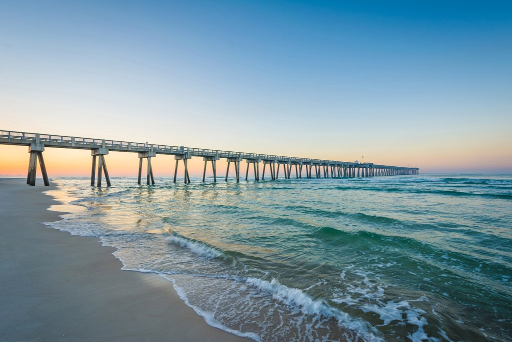 A beach in Florida, with a long wooden pier disappearing into the sea