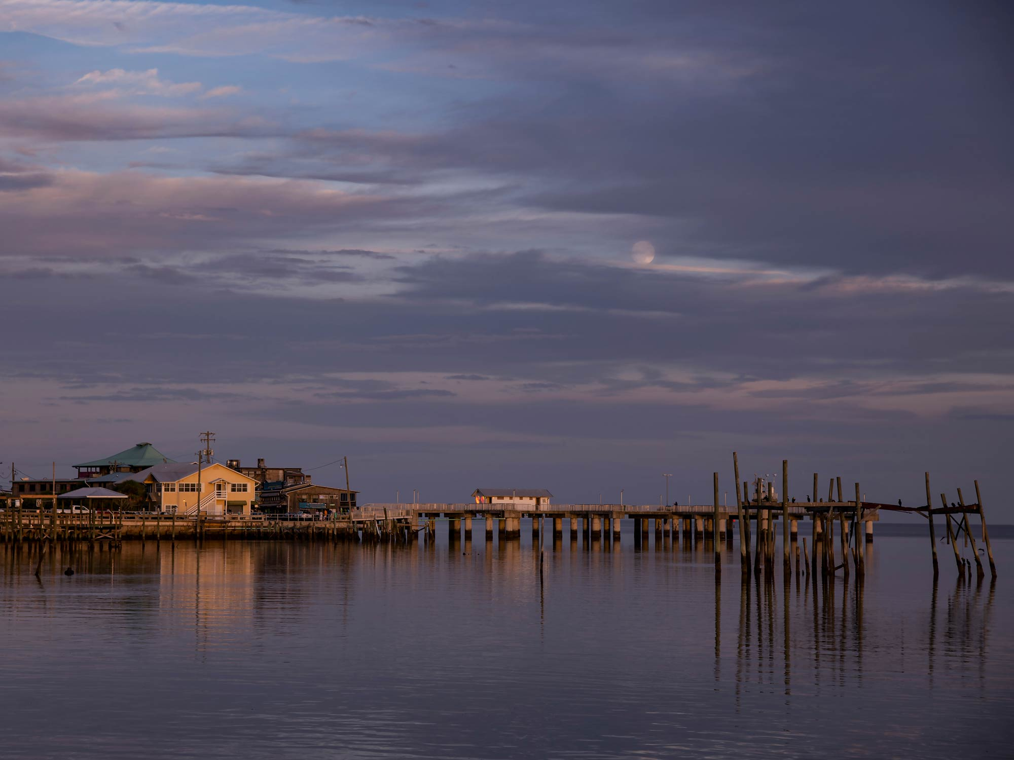 Evening sky with moonrise over Dock Street in Cedar Key, Florida