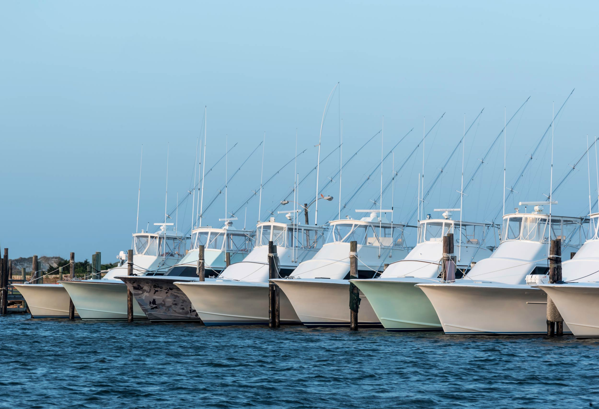 Fishing boats lined in a marina, ready for a fishing tournament