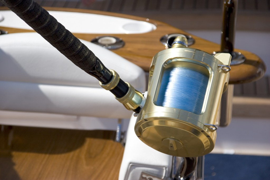 A heavy tackle trolling reel rigged with fluorocarbon line on a boat