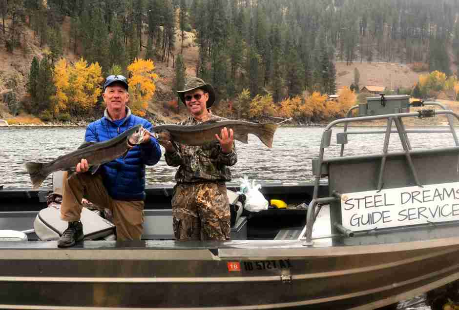Two men holding steelhead on clearwater river idaho
