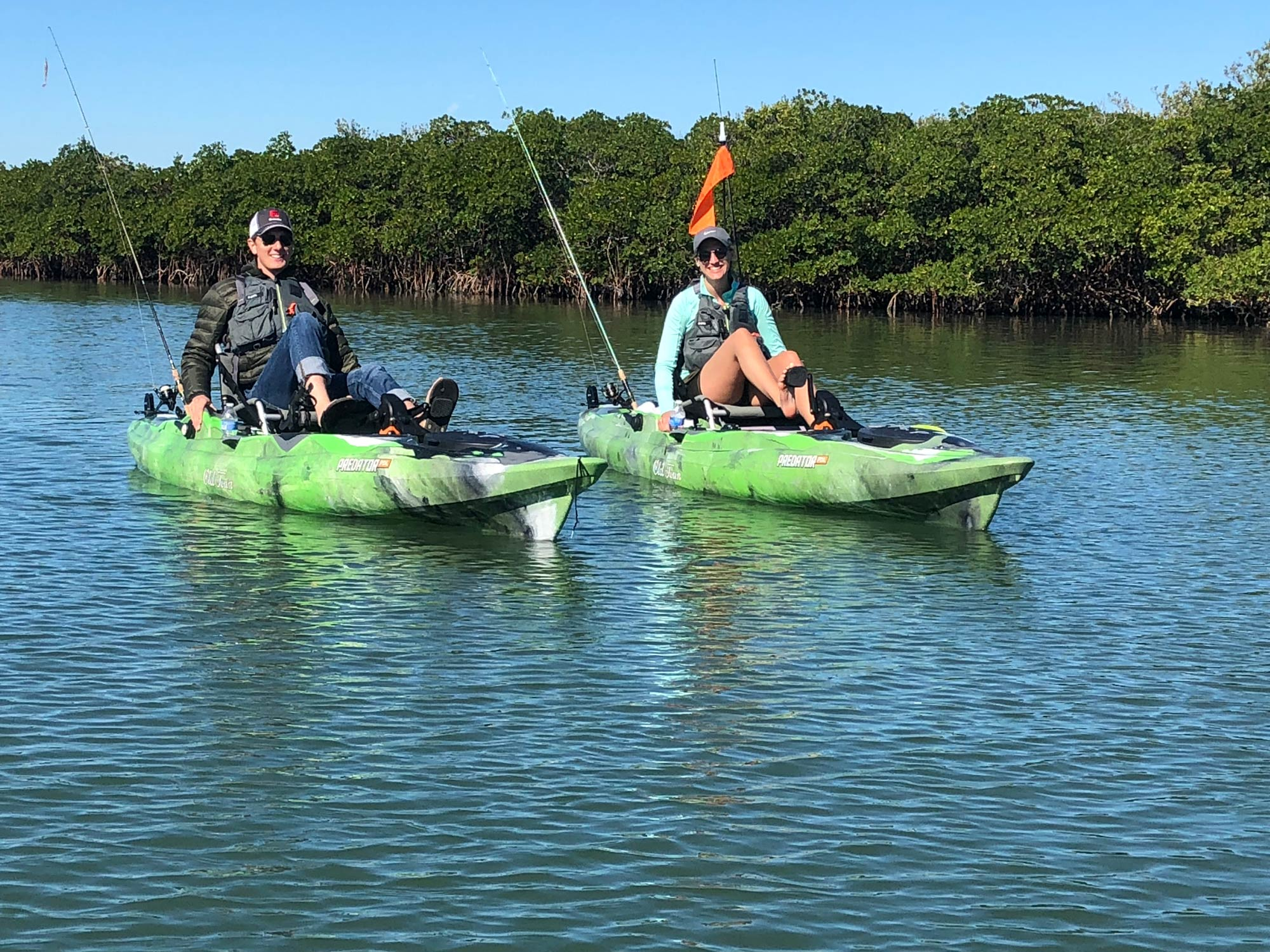 Two anglers paddling sided by side in kayaks