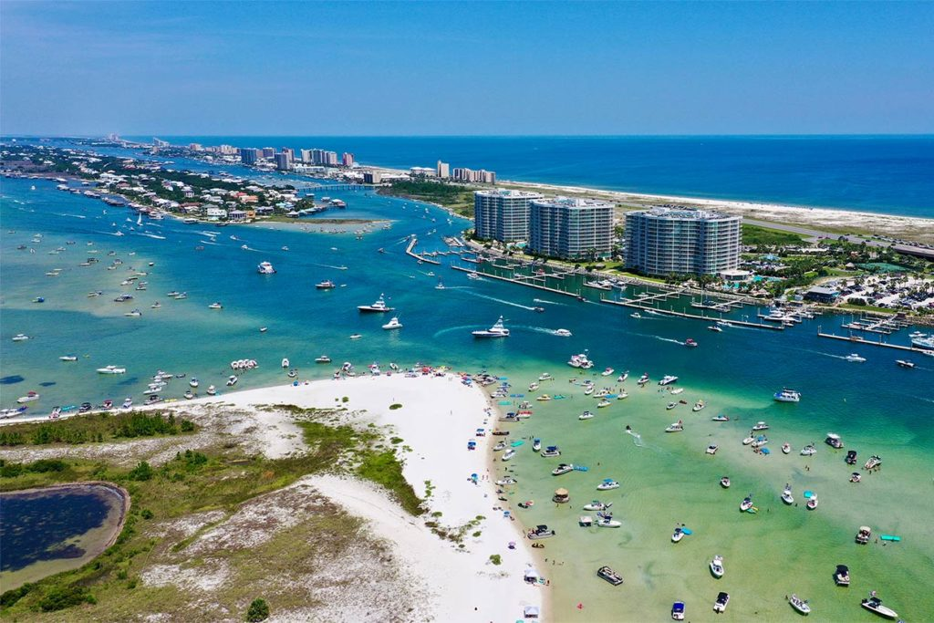 An aerial view of Orange Beach with the bay in the foreground