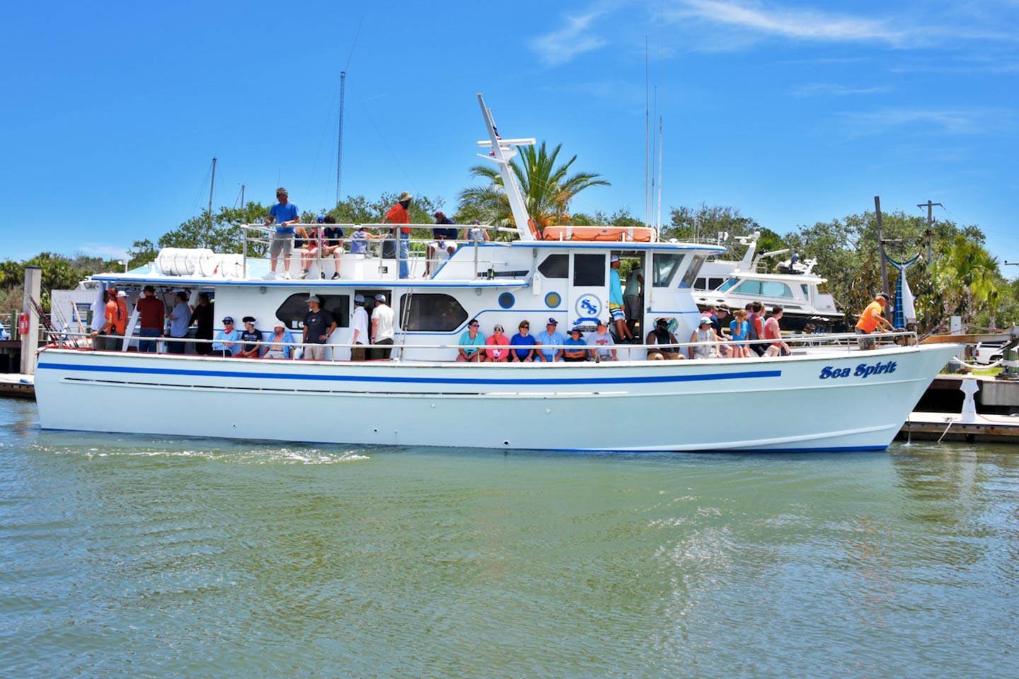 Party boat with multiple anglers heading out in New Smyrna Beach