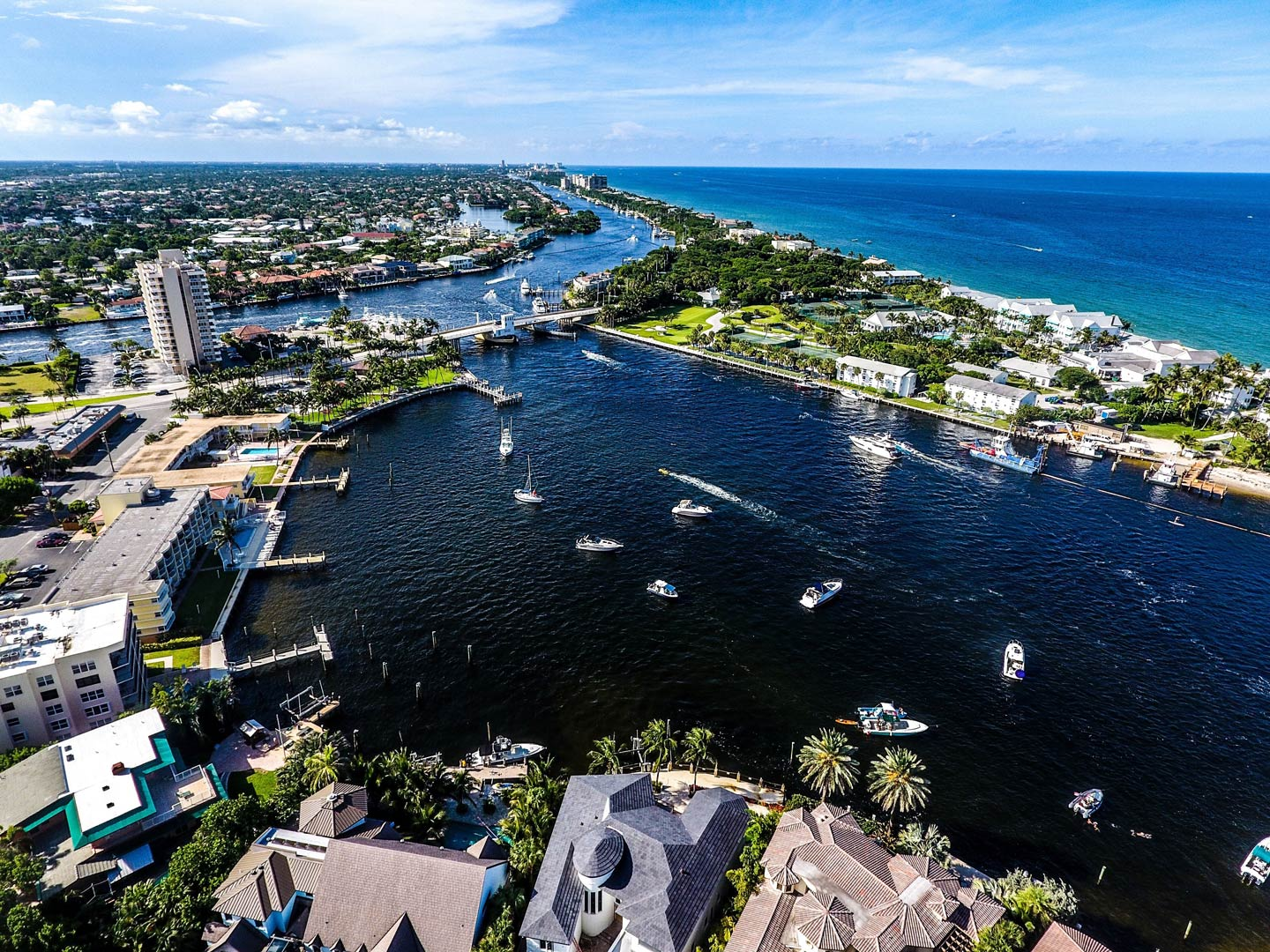 Aerial view of Pompano Beach with fishing boats leaving the bay