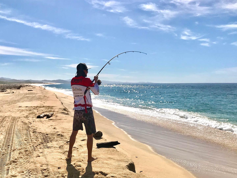 An angler casts from shore in Puerto Vallarta