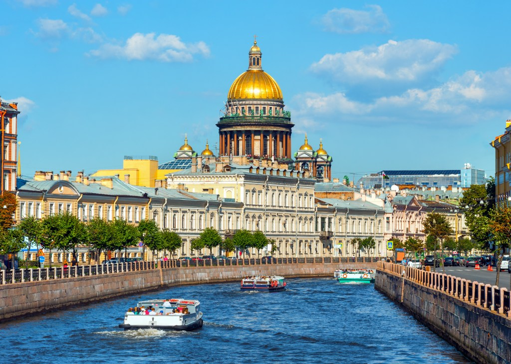 A view of Moyka River and Saint Isaac Cathedral in Saint Petersburg