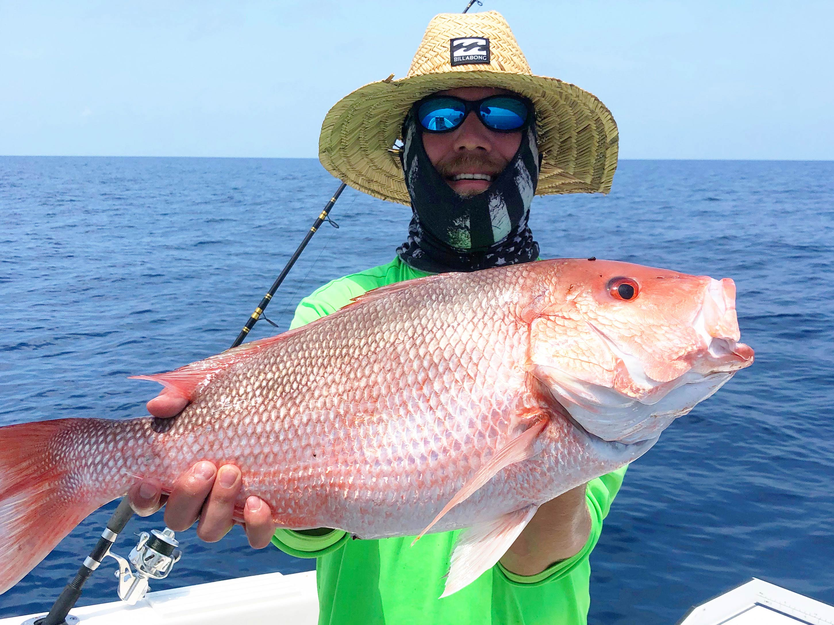 A satisfied fisherman holding a trophy Red Snapper