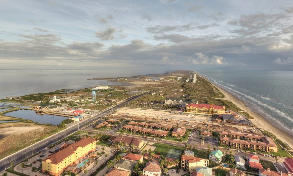An aerial view of South Padre Island with sea to the left and right of the island