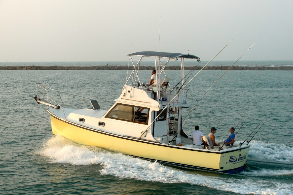 A charter boat in South Padre Island head out through Brazos Santiago Pass on the way offshore