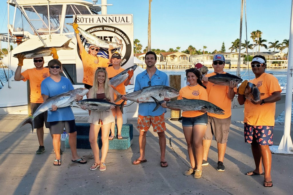 A group of anglers posing with the fish they caught at the South Padre International Fishing Tournament