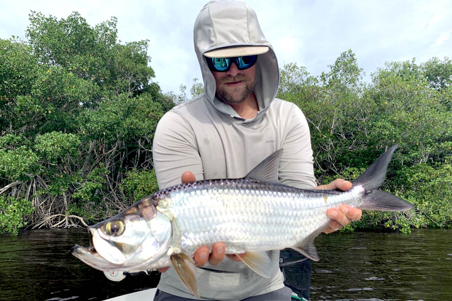 A man holding a Tarpon on a boat in Islamorada