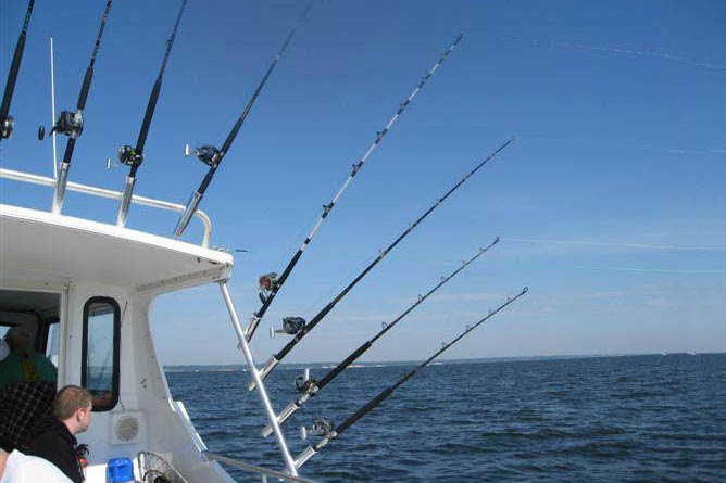 Lines troll from outriggers aboard a fishing vessel