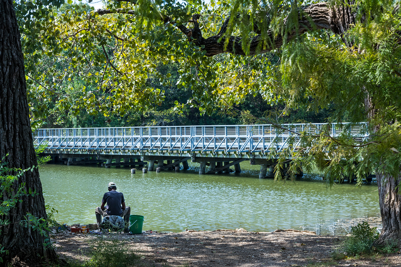 A man fishing on White Rock Lake in Dallas